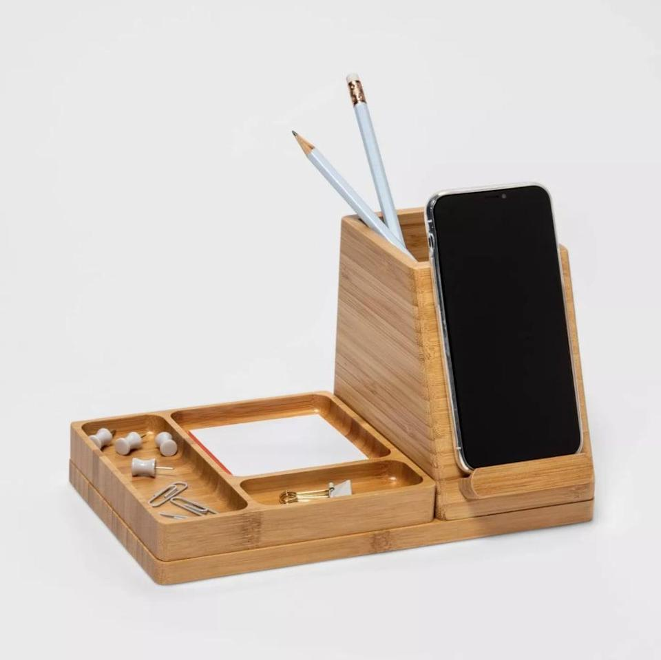 <p>Keep your phone and more on this <span>Project 62 Medium Bamboo Desk Storage</span> ($30).</p>