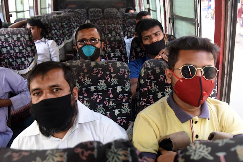 Bangladeshi people wearing facemasks during their travel amid fears of the spread of COVID-19 novel coronavirus, in Dhaka on March 10, 2020 (Photo by Mamunur Rashid/NurPhoto via Getty Images)