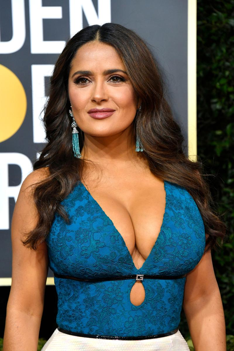Salma Hayek looks dazzling in elegant make-up and a dress that leaves nothing to imagination