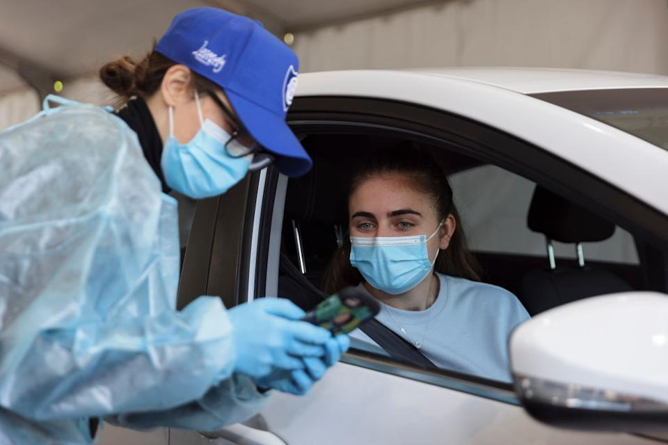 A patient arrives to receive a COVID-19 vaccine at a new drive-through vaccination clinic at Belmore Sports Ground.