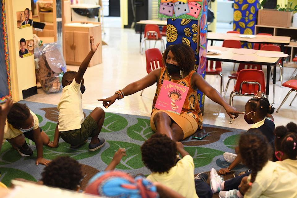 """Teacher Aaliyah Barclift reads the book """"I Like Myself!"""" to students at the Little Sun People preschool in the Brooklyn borough of New York City."""