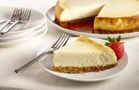 """<p>OK, cheesecake isn't a cheesy recipe in the traditional sense, but this dessert is so phenomenal and creamy, we just couldn't resist. Plus, it's virtually impossible to be sad while eating cheesecake.</p> <p><a href=""""https://www.thedailymeal.com/recipes/new-york-style-vanilla-cheesecake-recipe?referrer=yahoo&category=beauty_food&include_utm=1&utm_medium=referral&utm_source=yahoo&utm_campaign=feed"""" rel=""""nofollow noopener"""" target=""""_blank"""" data-ylk=""""slk:For the Vanilla Cheesecake recipe, click here."""" class=""""link rapid-noclick-resp"""">For the Vanilla Cheesecake recipe, click here.</a></p>"""