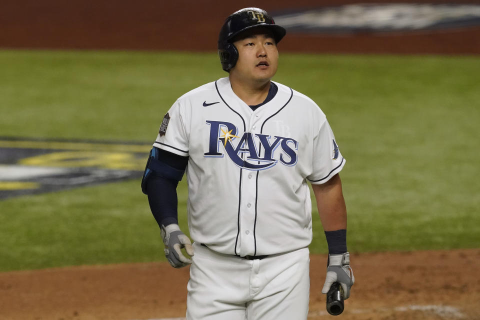 Tampa Bay Rays' Ji-Man Choi walks to the dugout after striking out during the second inning in Game 3 of the baseball World Series against the Los Angeles Dodgers Friday, Oct. 23, 2020, in Arlington, Texas. (AP Photo/Tony Gutierrez)