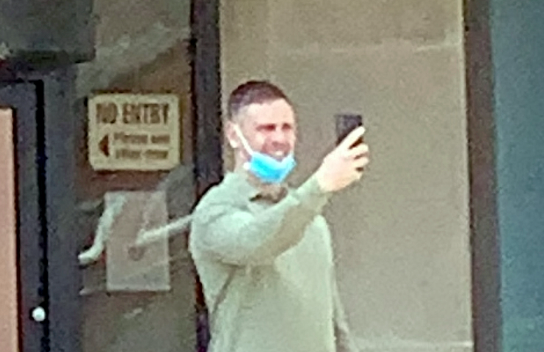 Nathan Buckley on his phone outside court after being found guilty of punching a pregnant woman. (SWNS)