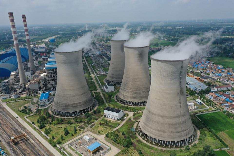 Steam billows out of the cooling towers