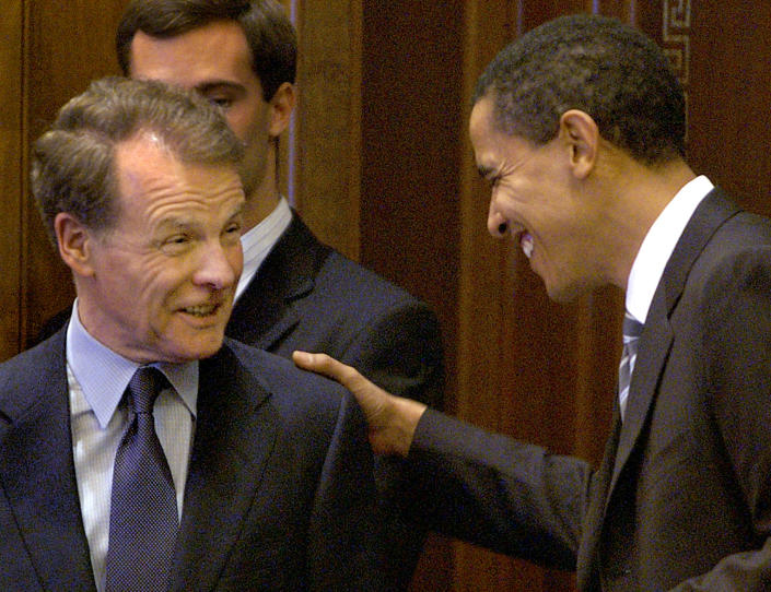 FILE - In this Nov. 8, 2004 file photo, then-U.S. Sen. Barack Obama, D-Ill., right, and then, Illinois Speaker of the House Michael Madigan, D-Chicago, left, appear in the Illinois State Capitol in Springfield, Ill. State Rep. Madigan, a Chicago Democrat who virtually set Illinois' political agenda as House speaker before he was ousted last month, announced Thursday, Feb. 18, 2021 that he is resigning his seat in the Legislature. Madigan once spoke disparagingly of then-U.S. Sen. Barack Obama, then sponsored legislation to erect Obama's presidential library in Chicago. (AP Photo/Seth Perlman File)