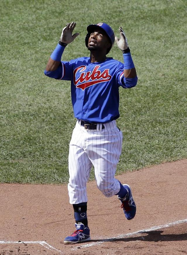 Chicago Cubs' Arismendy Alcantara celebrates after hitting a solo home run during the fifth inning of an interleague baseball game against the Baltimore Orioles in Chicago, Sunday, Aug. 24, 2014. (AP Photo/Nam Y. Huh)