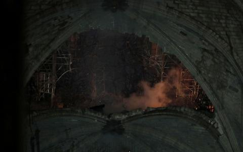 The huge hole in Notre-Dame's roof - Credit: Rex
