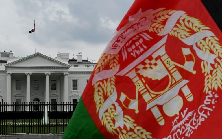 An Afghan flag is displayed outside the White House on August 31, 2021 (AFP/OLIVIER DOULIERY)