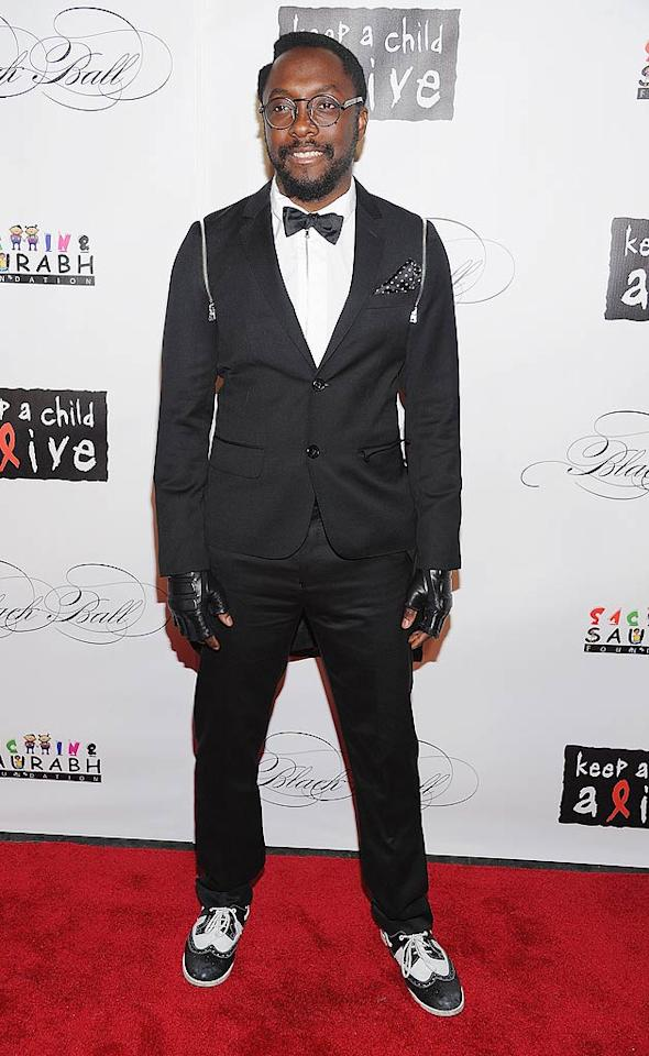 """The Black Eyed Peas' will.i.am added his own funky touches to an otherwise standard black suit. The singer hit the red carpet and the stage to perform """"I Gotta Feeling"""" -- with Alicia singing Fergie's part -- for the cause. (11/3/2011)"""
