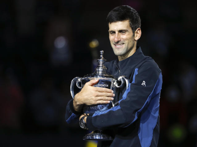 Novak Djokovic, of Serbia, holds the trophy after defeating Juan Martin del Potro, of Argentina, during the men's final of the U.S. Open tennis tournament, Sunday, Sept. 9, 2018, in New York. (AP Photo/Adam Hunger)