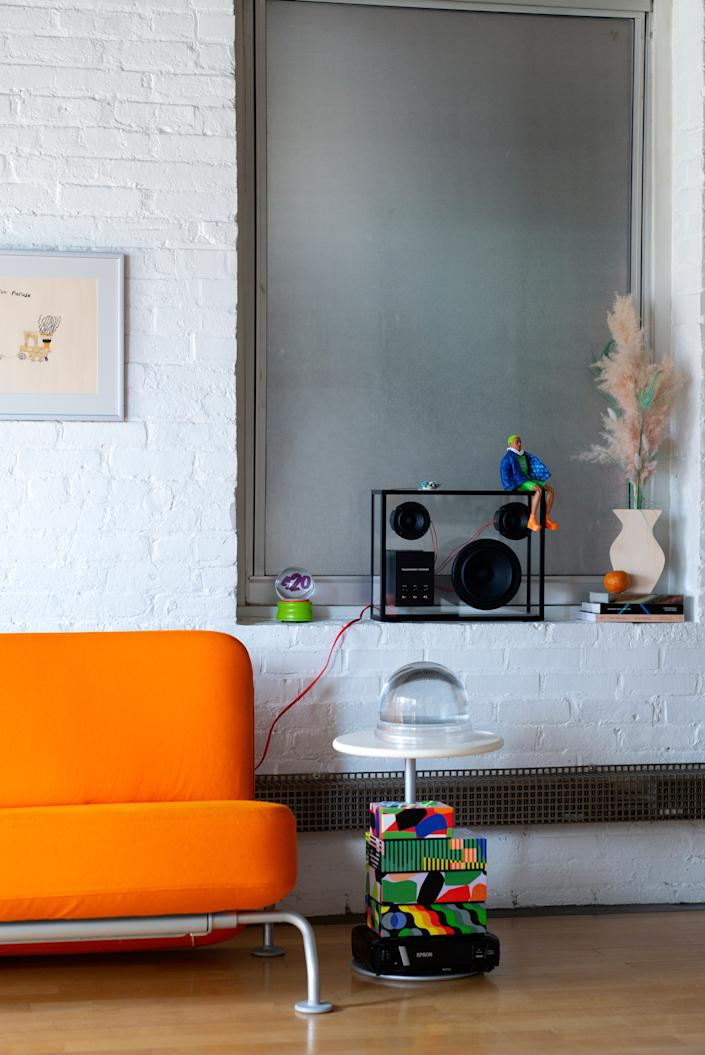 """<div class=""""caption""""> """"I love making arrangements of objects,"""" says Madde. Shown here: a stack of puzzles by <a href=""""https://www.architecturaldigest.com/story/inside-ellen-van-dusens-pattern-happy-brooklyn-brownstone?mbid=synd_yahoo_rss"""" rel=""""nofollow noopener"""" target=""""_blank"""" data-ylk=""""slk:Dusen Dusen"""" class=""""link rapid-noclick-resp"""">Dusen Dusen</a>, a Maison Margiela snow globe, a transparent speaker by <a href=""""https://transparentspeaker.com/"""" rel=""""nofollow noopener"""" target=""""_blank"""" data-ylk=""""slk:Transparent Sound"""" class=""""link rapid-noclick-resp"""">Transparent Sound</a>, and a <a href=""""https://biritestudio.com/products/plywood-bud-vase-by-pezzi"""" rel=""""nofollow noopener"""" target=""""_blank"""" data-ylk=""""slk:plywood vase by Pezzi"""" class=""""link rapid-noclick-resp"""">plywood vase by Pezzi</a> found at Bi-Rite. </div>"""
