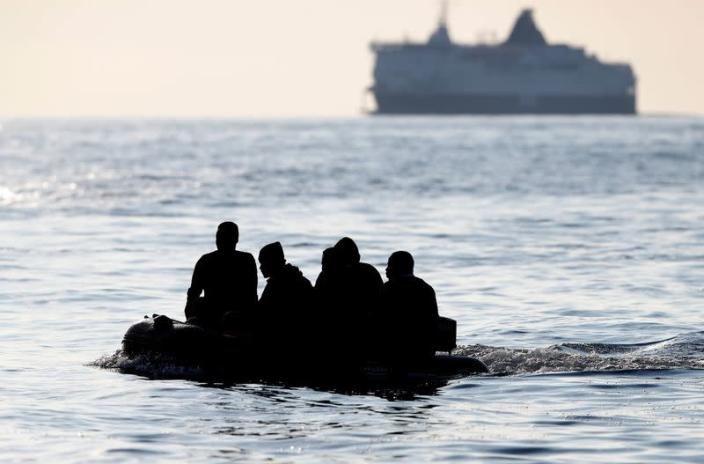 Migrants claiming to be from Darfur, Sudan cross the English Channel in an inflatable boat near Dover