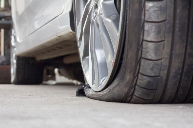 how to change a flat tire on a busy road How to repair a flat tire with a tire sealant kit changing a spare wheel is not a carrying out a puncture repair on the side of a busy road.
