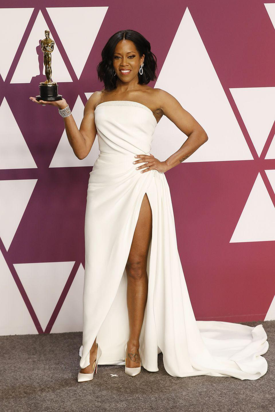 <p>Regina King poses with her first Oscar in an Oscar de la Renta dress. She won Best Supporting Actress for her performance in If Beale Street Could Talk. </p>