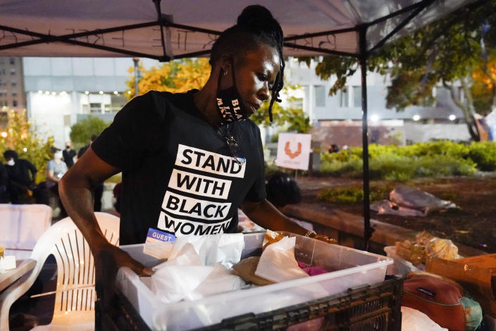 Rose Henderson helps out at a booth in Jefferson Square Park, Thursday, Sept. 24, 2020, in Louisville, Ky. A grand jury has indicted one officer on criminal charges six months after Breonna Taylor was fatally shot by police in Kentucky. The jury presented its decision against fired officer Brett Hankison Wednesday to a judge in Louisville, where the shooting took place. (AP Photo/Darron Cummings)