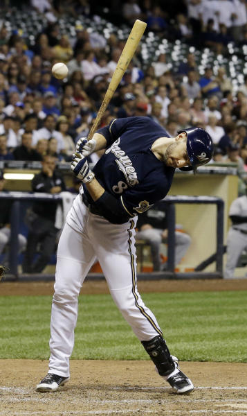 Milwaukee Brewers' Ryan Braun is hit by a pitch with the bases loaded during the seventh inning of a baseball game against the Colorado Rockies on Friday, June 27, 2014, in Milwaukee. (AP Photo/Morry Gash)
