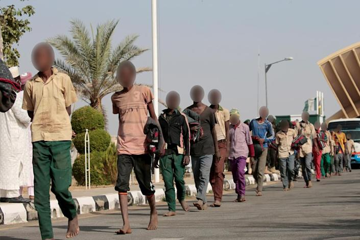Freed Nigerian schoolboys walk after they were rescued by security forces in Katsina, Nigeria, December 18, 2020.