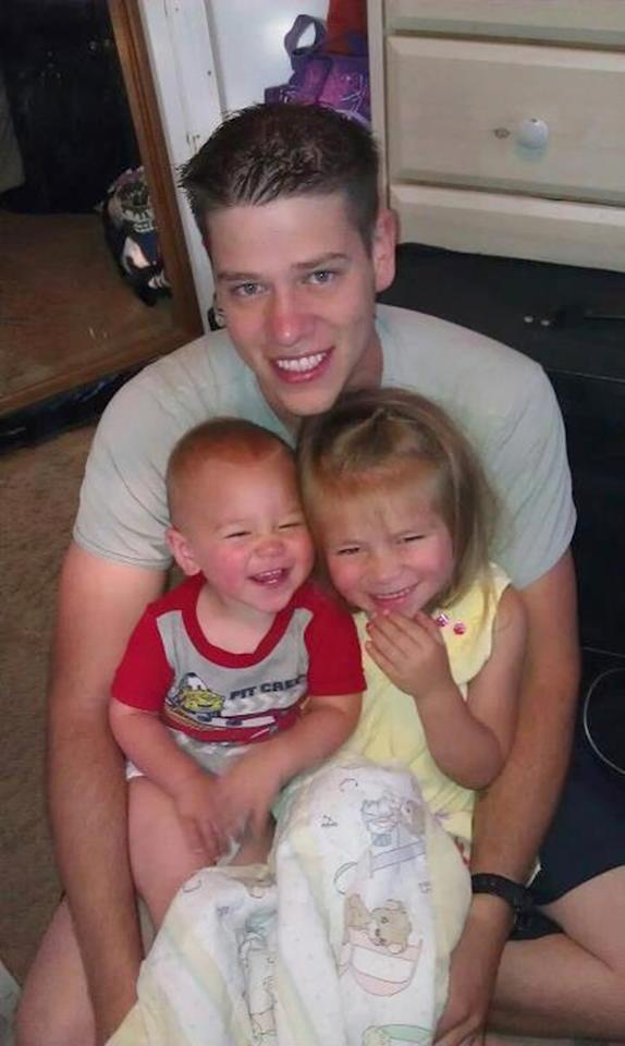 This undated photo provided by the family shows Jonathan T. Blunk, 26, of Aurora, Colo. with his two children. Blunk was one of the victims in the Friday, July 20, 2012 Aurora, Colo. movie theater shooting. (AP Photo)