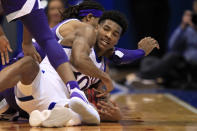 Kansas guard Ochai Agbaji (30) goes to the floor after the ball with Kansas State guard Cartier Diarra, back, during the second half of an NCAA college basketball game in Lawrence, Kan., Tuesday, Jan. 21, 2020. Kansas defeated Kansas State 81-59. (AP Photo/Orlin Wagner)