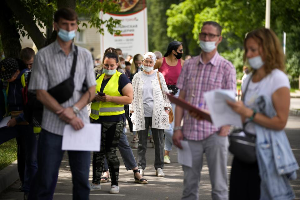 FILE - In this July 2, 2021, file photo, people wait in line to get a coronavirus vaccine at a vaccination center at VDNKh (The Exhibition of Achievements of National Economy) in Moscow, Russia. Countries across Europe are scrambling to accelerate coronavirus vaccinations to outpace the spread of the delta variant in a high-stakes race to prevent hospital wards from filling up again with patients fighting for their lives. Daily new case numbers are already climbing sharply in countries like the United Kingdom, Portugal and Russia. (AP Photo/Alexander Zemlianichenko, File)