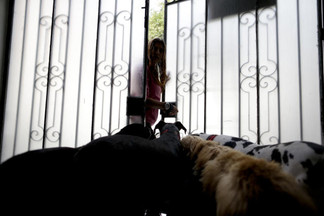 <p>Mariam Luzan is greeted by four of her dogs at the entrance of their temporary home in the aftermath of a 7.1-magnitude earthquake, in Mexico City, Friday, Sept. 22, 2017. (Photo: Natacha Pisarenko/AP) </p>
