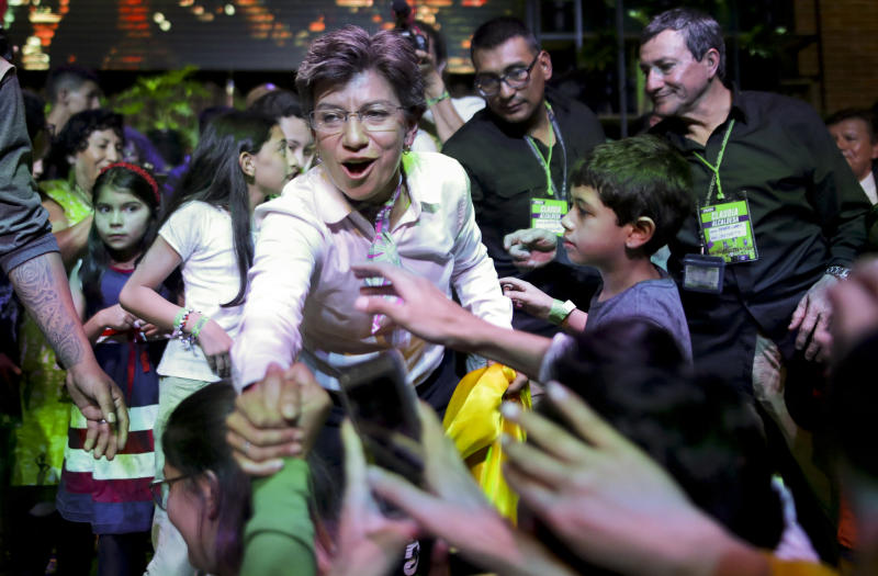 Claudia Lopez, candidate for mayor of Bogota with the Green Alliance, celebrates her election victory in Bogota, Colombia, Sunday, Oct. 27, 2019. Colombians went to the polls Sunday to choose mayors, state governors and local assemblies. (AP Photo/Ivan Valencia)