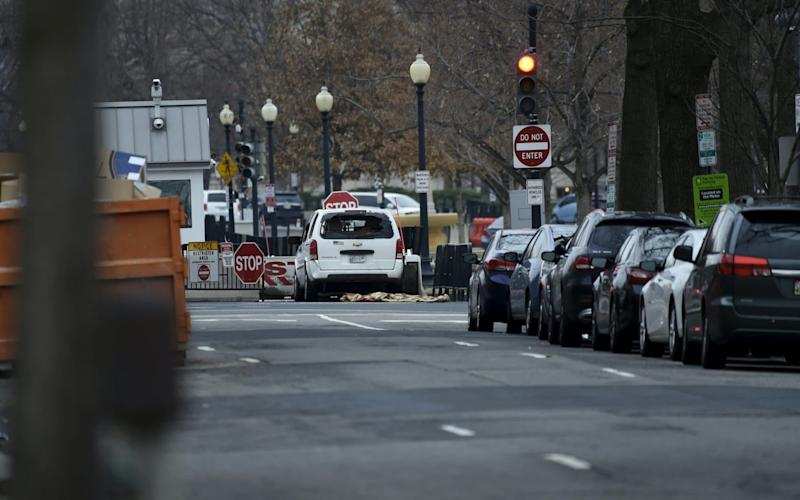 A woman has driven her car into the White House barricade - AFP