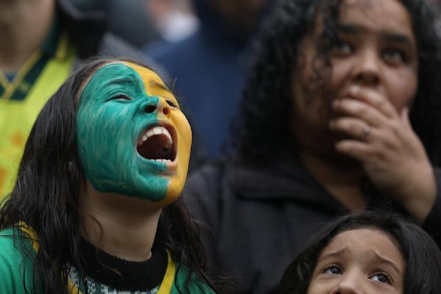 Soccer Football - World Cup - Quarter Final - Brazil vs Belgium - Porto Alegre, Brazil - July 6, 2018 - A fan reacts during the match. REUTERS/Diego Vara