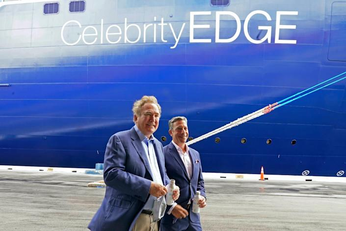 Richard Fain, Royal Caribbean Group's chairman and CEO, and Brian Abel, senior vice president of hotel operations and Celebrity Cruises, walking in front of the Celebrity Edge