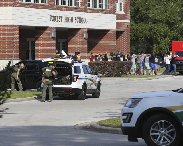 <p>Students are led out of Forest High School as law enforcement agents prepare to enter the school on Friday, April 20, 2018 in Ocala, Fla. (Photo: Bruce Ackerman/Star-Banner via AP) </p>