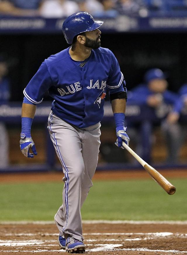 Toronto Blue Jays' Jose Bautista follows the flight of his fourth-inning home run off Tampa Bay Rays starting pitcher Matt Moore during a baseball game Wednesday, April 2, 2014, in St. Petersburg, Fla. (AP Photo/Chris O'Meara)