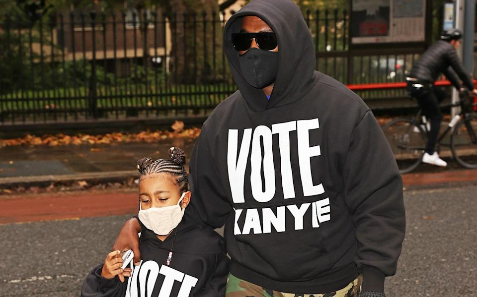 Kanye West with his daughter North, in London in October - Getty