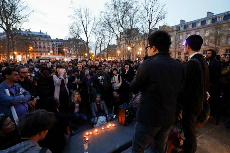 A man speaks during a demonstration for justice on the Place de la Republique on March 30, 2017 following the death of Chinese Liu Shaoyo during a police intervention (AFP Photo/FRANCOIS GUILLOT)
