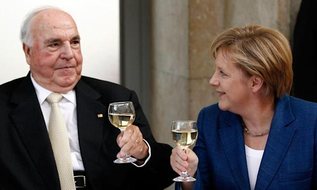 <p>Former German Chancellor Helmut Kohl (L) toasts with glasses of white wine with German Chancellor Angela Merkel after a ceremony of the Christian Democratic Union (CDU) party to mark the upcoming 20-year anniversary of the German unification in Berlin October 1, 2010. (REUTERS/Fabrizio Bensch) </p>