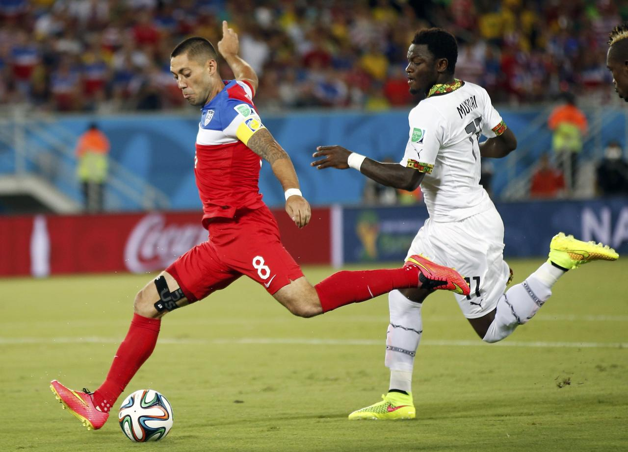 Clint Dempsey (L) of the U.S. shoots to score a goal past Ghana's Sulley Muntari during their 2014 World Cup Group G soccer match at the Dunas arena in Natal June 16, 2014. REUTERS/Toru Hanai (BRAZIL - Tags: SOCCER SPORT WORLD CUP TPX IMAGES OF THE DAY)