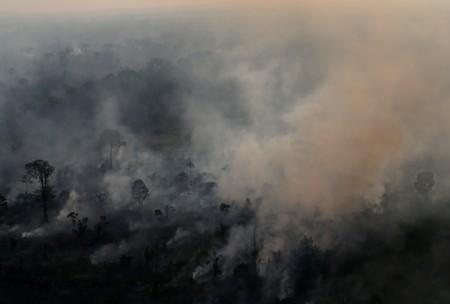 An aerial view of a burning tract of Amazon jungle as it is cleared by loggers and farmers near Porto Velho
