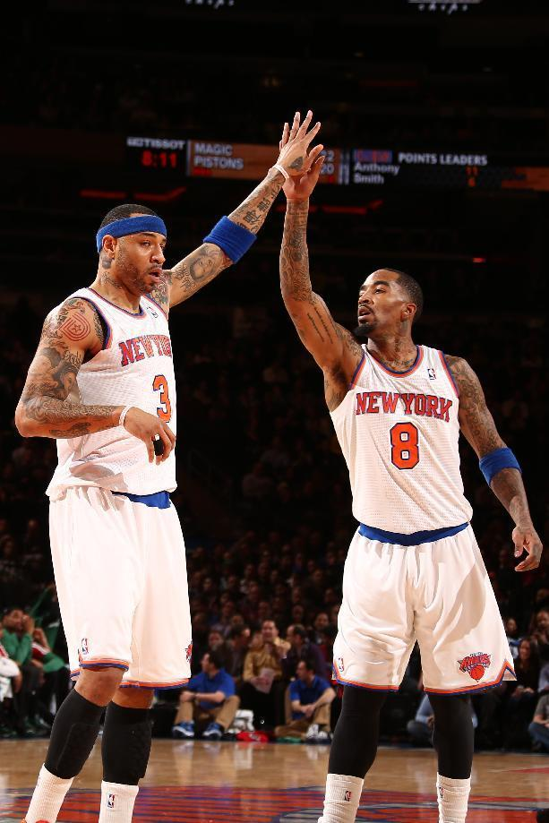 NEW YORK, NY - JANUARY 28: Kenyon Martin #3 of the New York Knicks high-fives teammate J.R. Smith #8 of the New York Knicks during a game against the Boston Celtics at Madison Square Garden in New York City on January 28, 2014. (Photo by Nathaniel S. Butler/NBAE via Getty Images)