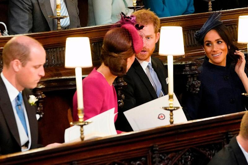 Prince William, Kate, Prince Harry and Meghan take their seats (AFP/Getty Images)