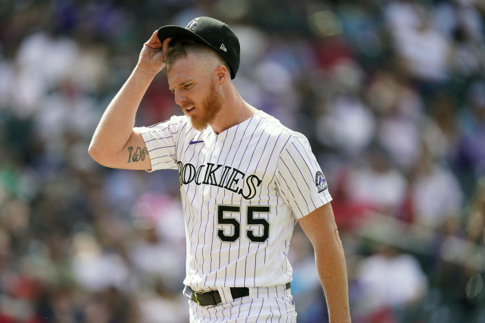 Colorado Rockies starting pitcher Jon Gray adjusts his cap as he heads to the dugout after retiring Philadelphia Phillies' Alec Bohm for the final out in the top of the sixth inning of a baseball game Sunday, April 25, 2021, in Denver. (AP Photo/David Zalubowski)