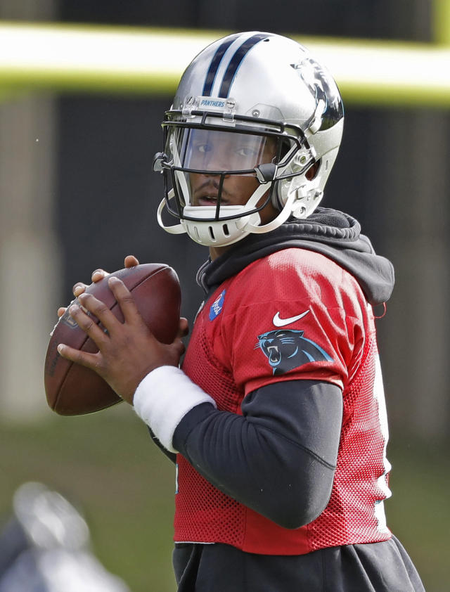 Carolina Panthers' Cam Newton (1) looks to pass during practice at the NFL football team's facility in Charlotte, N.C., Tuesday, May 22, 2018. While NFL owners are voting to approve the new Panthers owner in Atlanta, the team David Tepper is about to officially own takes to the field for the OTAs back in Charlotte with plenty of new faces.(AP Photo/Chuck Burton)