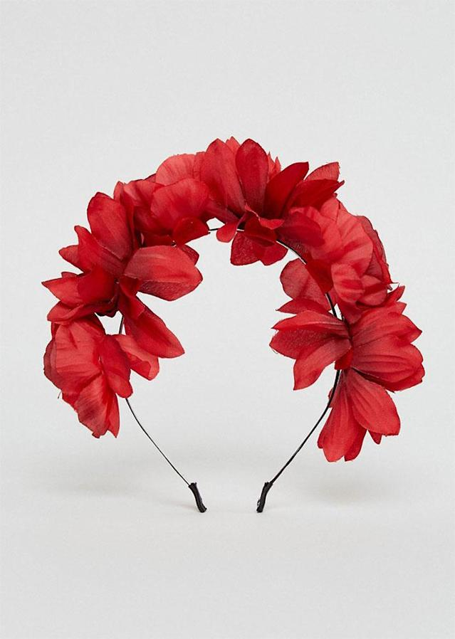 "You'll blossom in this floral arrangement. $13; at <a href=""http://us.asos.com/asos/asos-halloween-midnight-floral-garland-headband/prd/8347055?clr=burgundy&cid=11412&pgesize=36&pge=0&totalstyles=225&gridsize=3&gridrow=1&gridcolumn=3"" rel=""nofollow noopener"" target=""_blank"" data-ylk=""slk:ASOS"" class=""link rapid-noclick-resp"">ASOS</a>"