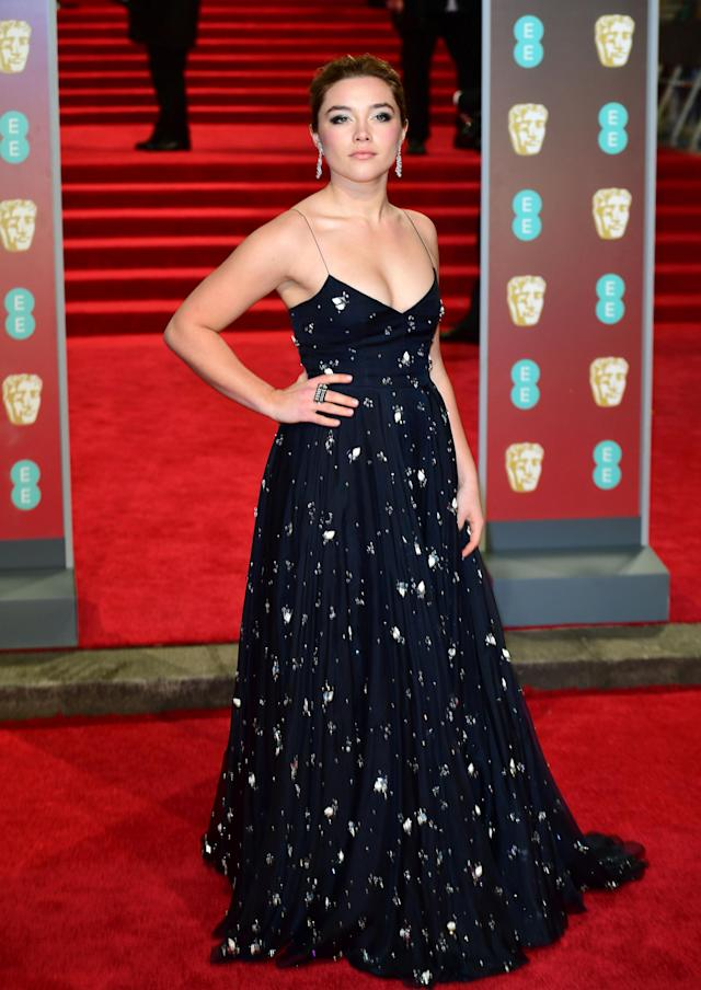 <p>The rising British actress was another star to bare her arms in a strappy, floor-sweeping gown. <em>[Photo: Getty]</em> </p>