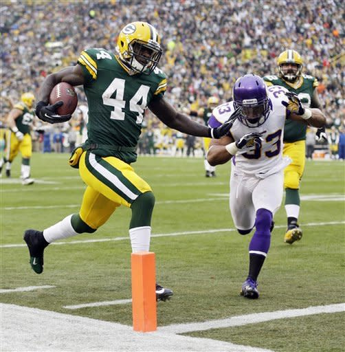 Green Bay Packers running back James Starks gets past Minnesota Vikings strong safety Jamarca Sanford (33) for a 22-yard touchdown run during the second half of an NFL football game Sunday, Dec. 2, 2012, in Green Bay, Wis. The Packers won 23-14. (AP Photo/Morry Gash)