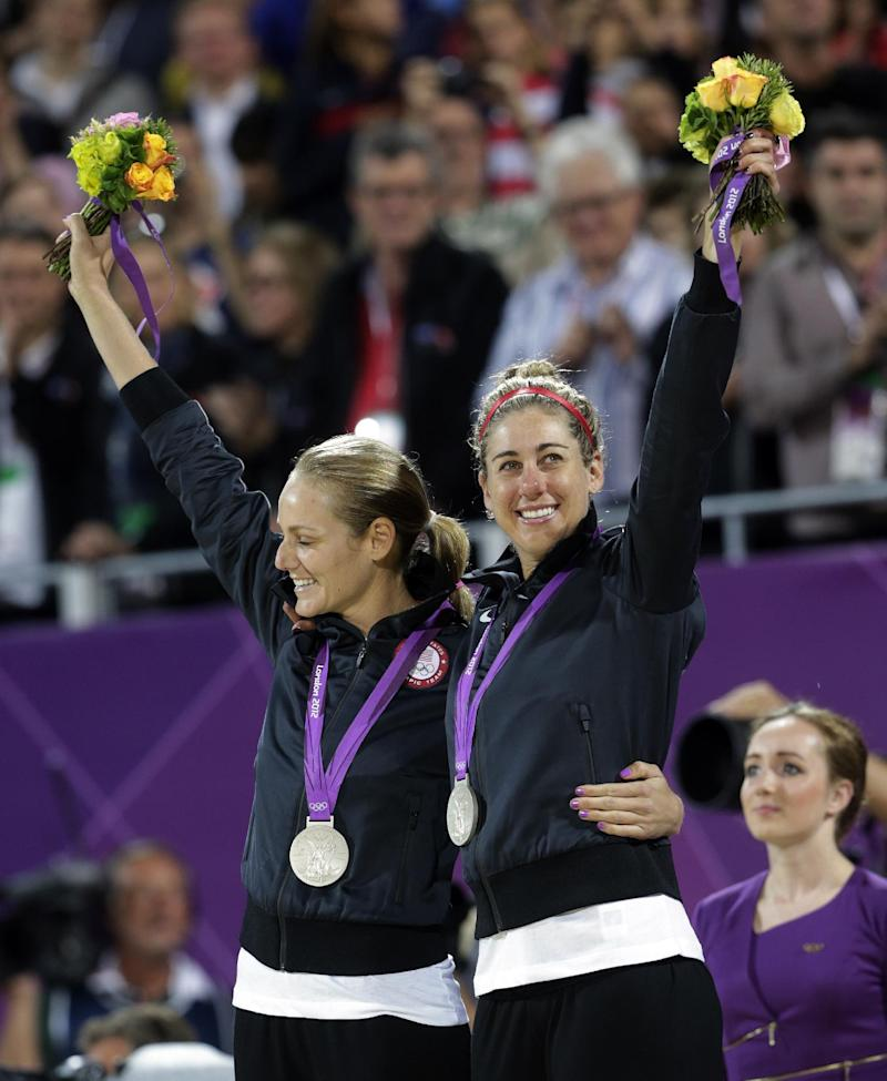 The United States Jennifer Kessy, left, and April Ross celebrate with their silver medals following the women's Gold Medal beach volleyball match between the two United States teams  at the 2012 Summer Olympics, Wednesday, Aug. 8, 2012, in London. (AP Photo/Dave Martin)