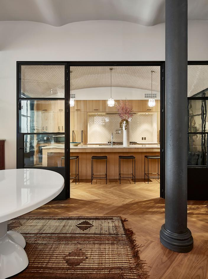 "<div class=""caption""> The entrance of a New York City loft designed by Aamir Khandwala for a longtime client is multitextured, between the gel of the 1960s table from designer <a href=""https://www.wendellcastle.com/"" rel=""nofollow noopener"" target=""_blank"" data-ylk=""slk:Wendell Castle"" class=""link rapid-noclick-resp"">Wendell Castle</a> and the leather of the Mauritanian rug from <a href=""https://rwguild.com/"" rel=""nofollow noopener"" target=""_blank"" data-ylk=""slk:RW Guild"" class=""link rapid-noclick-resp"">RW Guild</a>. In the kitchen, gemlike hanging lights from designer <a href=""https://www.come.fr/"" rel=""nofollow noopener"" target=""_blank"" data-ylk=""slk:Christophe Côme"" class=""link rapid-noclick-resp"">Christophe Côme</a> brighten the island, which is lined with black stools from <a href=""https://www.gestaltnewyork.com/grazia-co"" rel=""nofollow noopener"" target=""_blank"" data-ylk=""slk:Grazia and Co"" class=""link rapid-noclick-resp"">Grazia and Co</a>. </div>"