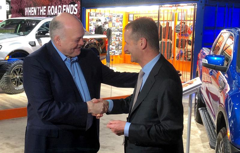 The President and CEO of Ford Motor Company Hackett shakes hands with Volkswagen CEO Diess at the North American International Auto Show in Detroit