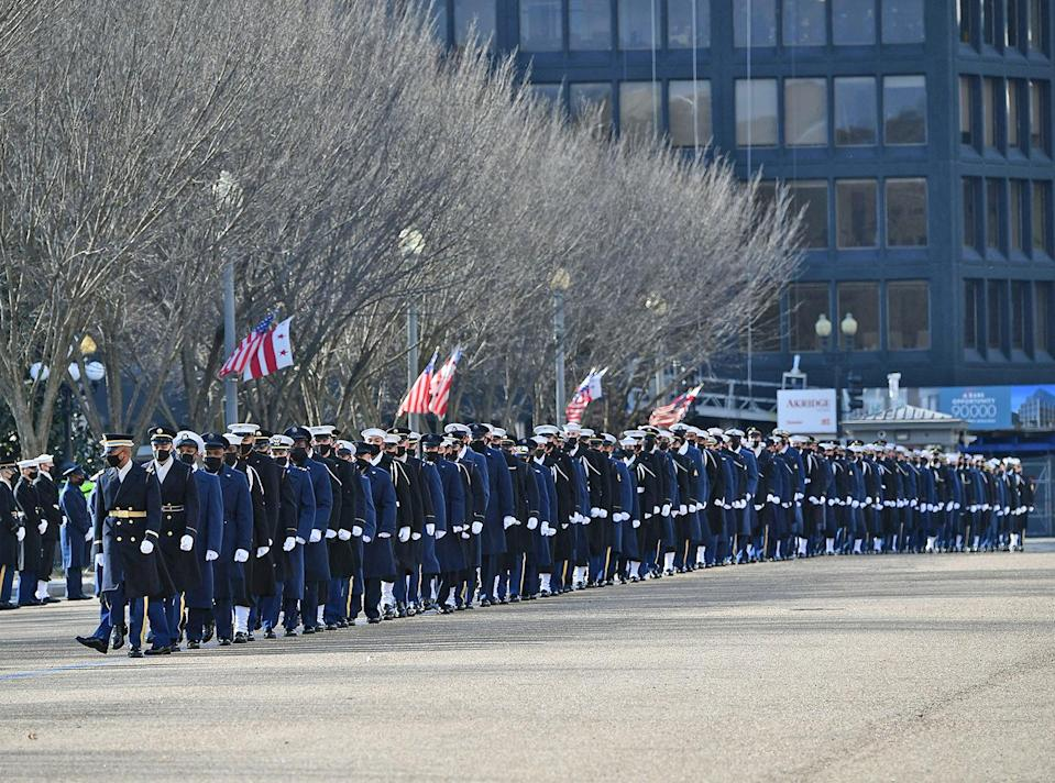 <p>The honor guard is seen stretching back down the avenue. </p>