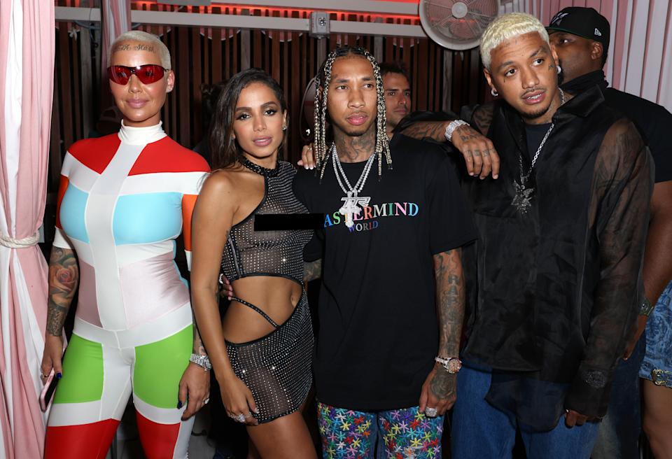 MIAMI BEACH, FLORIDA - APRIL 30: (EDITORS NOTE: This image contains partial nudity) (L-R) Amber Rose, Anitta, Tyga and Alexander Edwards attend the A Night From Rio