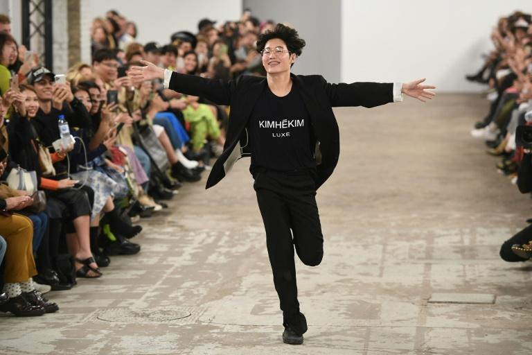 Designer Kiminte Kimhekim acknowledges the crowd at as fashion show in Paris in 2019